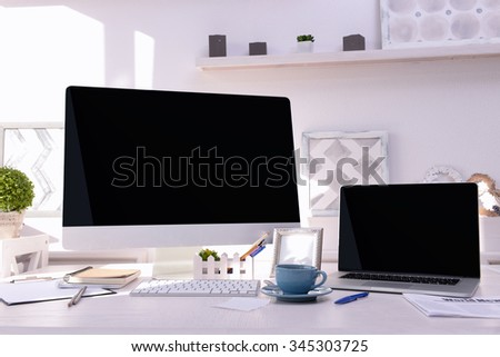 Workplace with computer and laptop on the table - stock photo