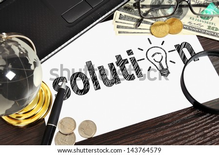 workplace with drawing solution on paper - stock photo
