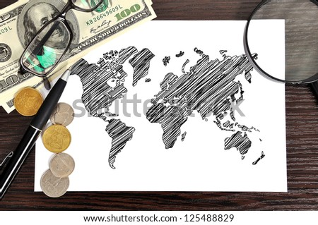 workplace with drawing world map on paper - stock photo