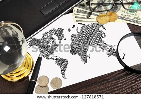workplace with drawing world map on paper and money - stock photo