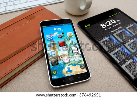 Workplace with modern mobile phone on table close-up