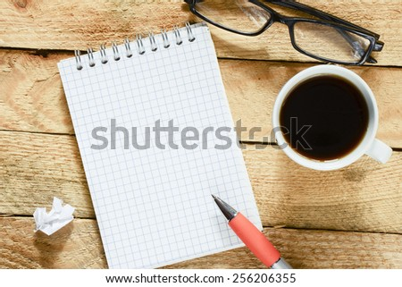 Workplace with notebook and coffee. - stock photo