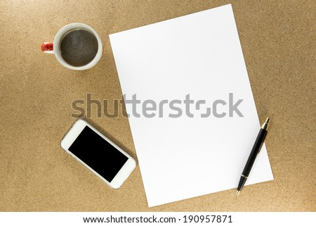 Workplace with phone,paper, pen and cup of coffee on work table top view - stock photo