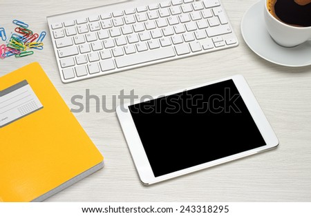 Workplace with tablet and keyboard, coffee - stock photo