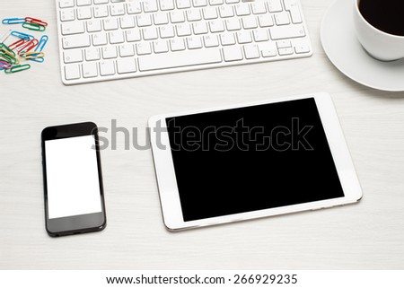 Workplace with tablet and keyboard, phone