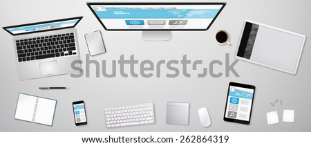 Workplace with tablet computer and mobile phone on table