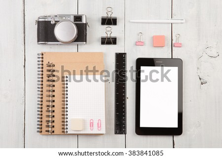workplace with tablet pc, notepads, camera, ruler and pen. Top view - stock photo