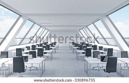Workplaces in a bright modern open space loft office. White tables equipped by modern laptops and black chairs. New York panoramic view in the windows. 3D rendering.