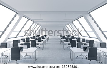 Workplaces in a bright modern open space loft office. White tables equipped by modern laptops and black chairs. White copy space in the panoramic windows. 3D rendering.