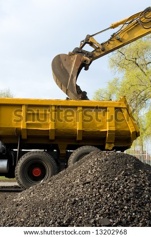 Works in an industrial zone in construction witch excavator machines