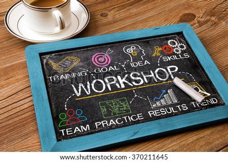 workshop concept on blackboard - stock photo