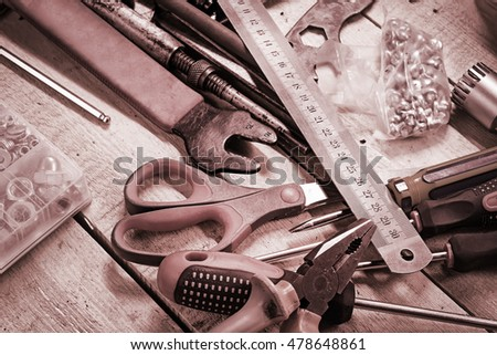 Workshop desktop with various tools. Toned image