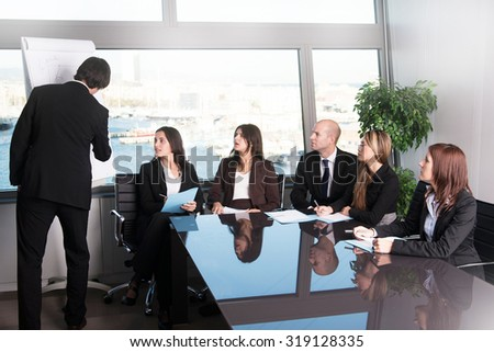 Workshop in a training boardroom with six businesspeople  - stock photo