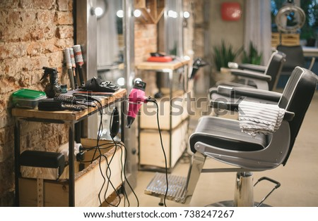 Beauty Salon With Chairs, Hair Dryers, Combs And Mirrors