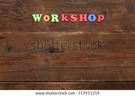 Workshop title with copyspace on wooden background