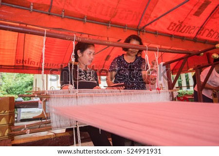 workshop to weave cotton on the manual wood loom in Asian traditional culture in Prajeenburi, Thailand 28 November 2016
