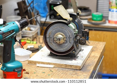 Workshop with sharpener and other tools - stock photo