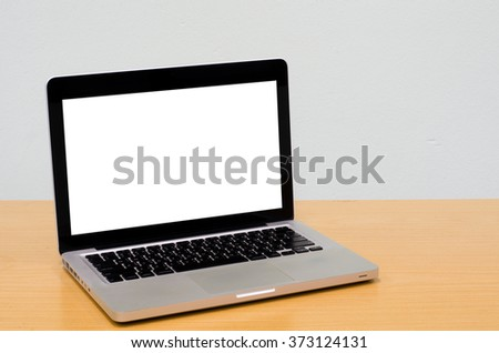 Workspace background, Blank white computer screen, monitor screen on wooden desk, Computer on table - stock photo
