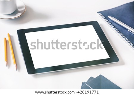 Workspace with Digital tablet Mockup on table with white blank screen