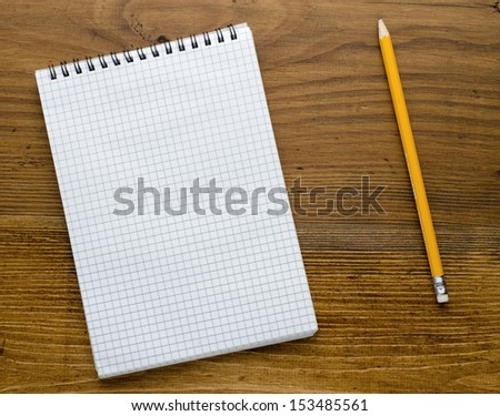 Workspace with notebook on old wooden table - stock photo