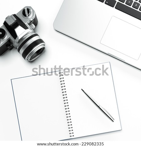 Workspace with notepad and pen - stock photo