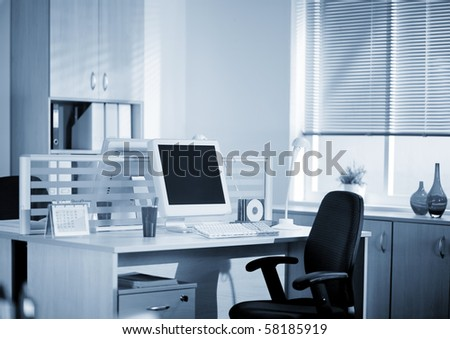 workstation in the office before work - stock photo