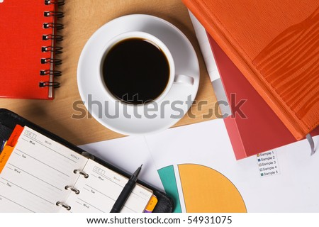 Worktable covered with documents, view from above - stock photo