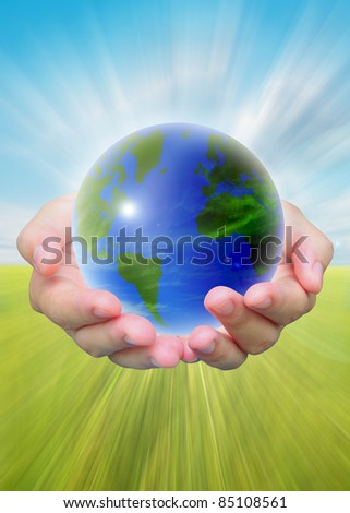 world and women hand holding on blue sky - stock photo