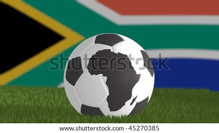 World cup 2010 South Africa theme with a soccer ball with print of  the Africa continent.  The South African flag is out of focus on the background. - stock photo
