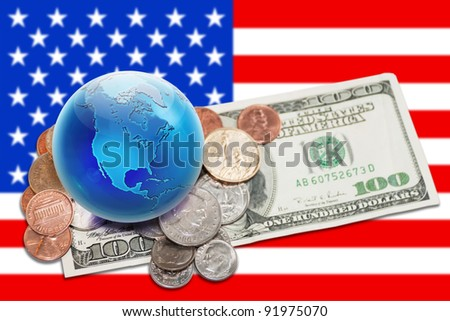 World currency. Globe view to North America on dollar coins and banknote. Focus on globe. - stock photo
