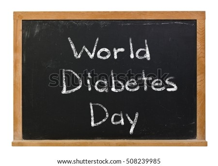 World Diabetes Day written in white chalk on a black chalkboard isolated on white