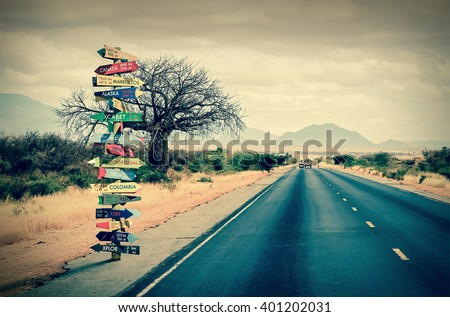 World directions signpost with distance to many different countries - stock photo