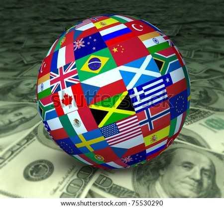 World economy symbol represented by a global sphere with international flags sitting on a floor of currency. - stock photo