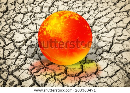 World Environment Day,Earth day concept and Hot Earth from burning .Fire burning the world ball on the soil cracked. Elements of this image furnished by NASA.clipping path - stock photo
