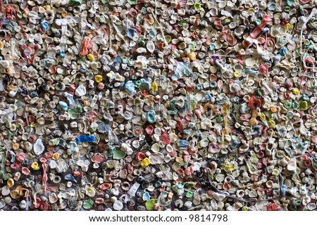 World famous gum wall in Post Alley Seattle Washington. A wall covered in chewing gum. Also makes a great abstract background - stock photo