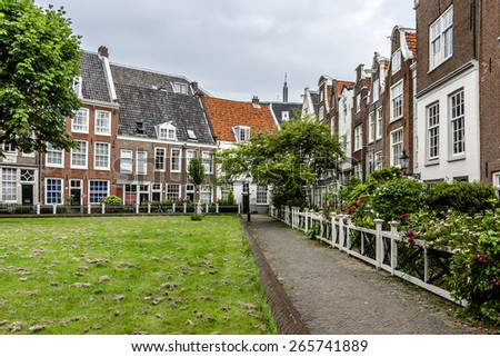 World famous historic Begijnhof is one of the oldest inner courts in the city of Amsterdam. Begijnhof was founded during the middle Ages. Netherlands. - stock photo