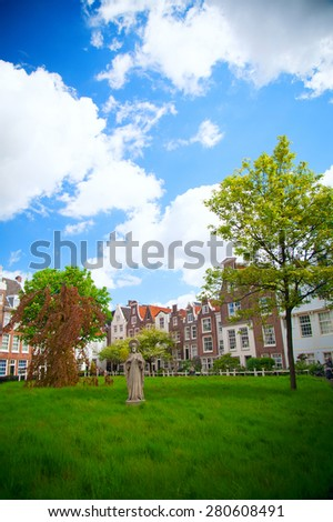 World famous historic Begijnhof is one of the oldest inner courts in the city of Amsterdam.  Netherlands. - stock photo