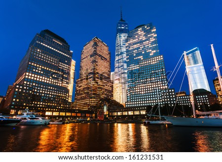 World Financial Center at night viewed from the Hudson river, New York, USA
