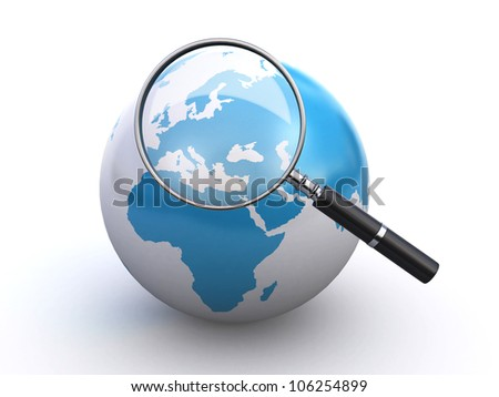 world globe and a magnifying glass - stock photo
