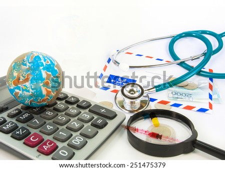 World globe , calculator,magnifying glass on white background. abstract background to solution of import,export,and on line international commercial. - stock photo