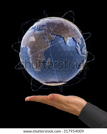 World Globe - Infographic Presentation. CG model of a globe above the facing up palm of a men's hand on black background. Photo and graphic compositing. - stock photo