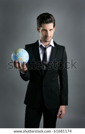 World globe map sphere in businessman hand over dark gray background