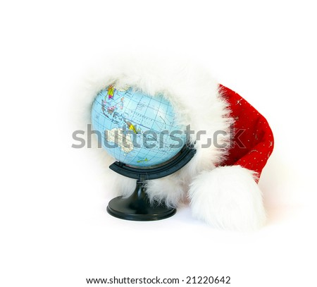 World globe (Russian) and Santa Claus hat on white - stock photo