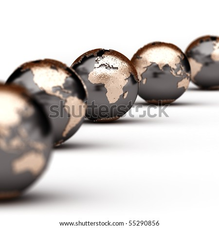 World globes showing different parts of the world with very shallow depth of field - stock photo