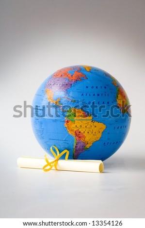 World glove and diploma - stock photo