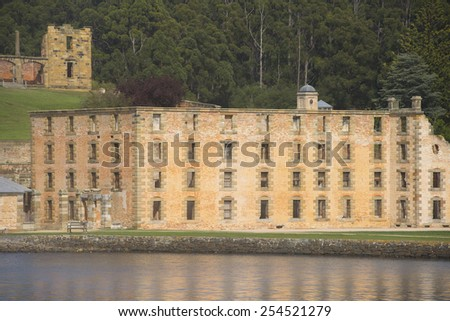 World Heritage Site of former Penal Convict Settlement Port Arthur on Tasmania, Australia, with ruin of prison at water of harbour and other old buildings. - stock photo