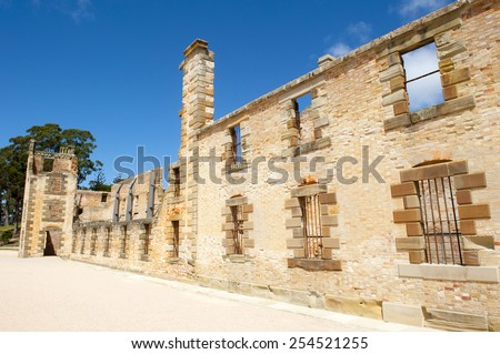 World Heritage Site of  Port Arthur Convict Museum Settlement in Tasmania, Australia, with relict of historic prison building, tourist attraction, blue sky, copy space. - stock photo