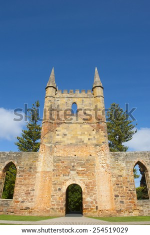 World Heritage Site of  Port Arthur Convict Museum Settlement in Tasmania, Australia, with ruins of historic church, tourist attraction and destination. - stock photo