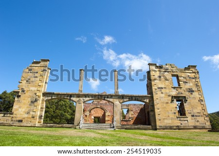 World Heritage Site of  Port Arthur Convict Museum Settlement in Tasmania, Australia, with ruins of historic hospital building, tourist attraction, blue sky copy space. - stock photo