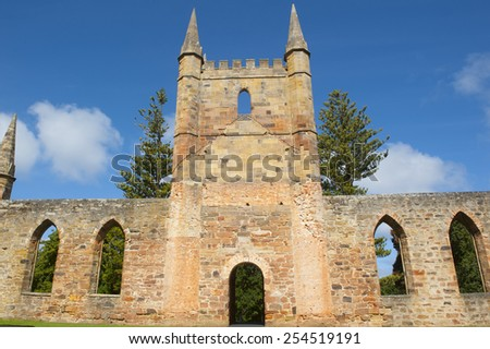 World Heritage Site of  Port Arthur Convict Museum Settlement in Tasmania, Australia, with ruins of historic church and other buildings, tourist attraction and destination. - stock photo